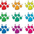 Stock Vector: Vector set of colorful dog's foot prints