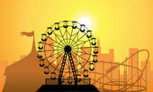Vector silhouettes of a city and amusement park — Vector de stock