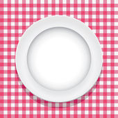 Vector tablecloth and empty plate — Stock Vector
