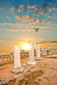 Ancient Greek columns at sunset — Stock Photo