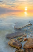 The stones stretching into the sea — Stock Photo