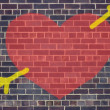 Stock Photo: Valentine's Day heart and arrow graffiti on brick wall backgroun