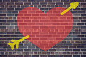 Valentine's Day heart and arrow graffiti on brick wall backgroun — Stock Photo