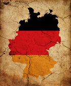 Germany grunge map outline with flag — Stock Photo