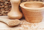 Mustard Seeds in rustic kitchen setting with pestle and mortar — Stock Photo
