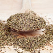 Thyme on wooden serving spoon with selective focus - Stock Photo
