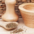 Cumin Seeds in rustic kitchen scene with wooden utensils — Stockfoto #9506043
