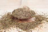 Thyme on wooden serving spoon with selective focus — Stock Photo