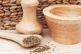 Cumin Seeds in rustic kitchen scene with wooden utensils — Stock Photo
