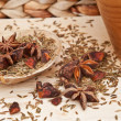 Star Anise and cumin seeds in rustic kitchen setting with wooden - Stock Photo