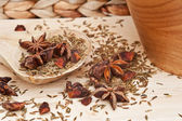 Star Anise and cumin seeds in rustic kitchen setting with wooden — Stock Photo