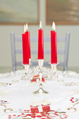Candles in a candlestick on a table — Stock Photo