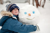 The child and the Snowman — Stock Photo