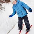 Little boy on skis. winter's day — Stock fotografie