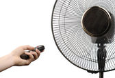 Fan and hand with remote control — Stock Photo