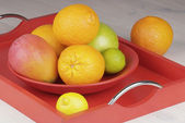 Tropical fruit in a bowl on the table — Stock Photo