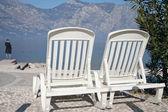Beautiful lake beach with armchairs — Stock Photo