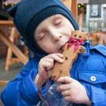 Enjoying christmas gingerbread — Stock Photo
