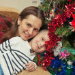 Portrait of mother and son wearing near Christmas tree — Stock Photo #8932529