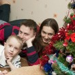 Family of three at home celebrating Christmas — Stock Photo #8943916