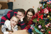 Family of three at home celebrating Christmas — Stock Photo