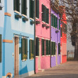 Bright houses in Burano island: blue, pink, violet, red - Stock Photo