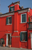 Bright red house in Burano island, Venice — Stock Photo