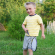 Stock Photo: Funny little boy playing in badminton