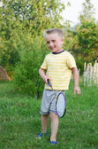 Funny little boy playing in badminton — Stock Photo