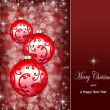 Christmas ornaments on a dark red background — Стоковая фотография