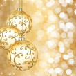 Three beautiful golden christmas balls on a golden background — Zdjęcie stockowe