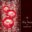 Christmas ornaments on a dark red background — 图库照片