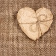 Foto Stock: Paper heart on burlap