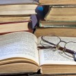 Pile of old books and glasses - Stock Photo
