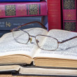 Vintage books with glasses on wooden table — Stock Photo