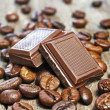图库照片: Coffee beans and chocolate