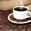 Stock Photo: Cup of coffee coffee beans
