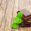 Dark chocolate with fresh mint leaves — Stok fotoğraf