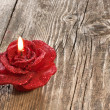 Red rose shaped candle — Stok fotoğraf