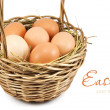 Brown eggs at hay in the basket — Stock Photo
