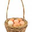 Royalty-Free Stock Photo: Brown eggs at hay in the basket