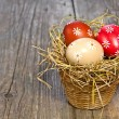 Colorful easter egg in the basket — Stock Photo