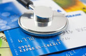 A stethoscope by a Credit cards — Stock Photo