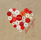 Old plastic buttons in a heart shape — Stock Photo