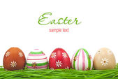 Decorated easter eggs in grass — Stock Photo