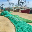 Stock Photo: Commercial fishing boats and nets