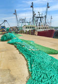 Commercial fishing boats and nets — Stock Photo