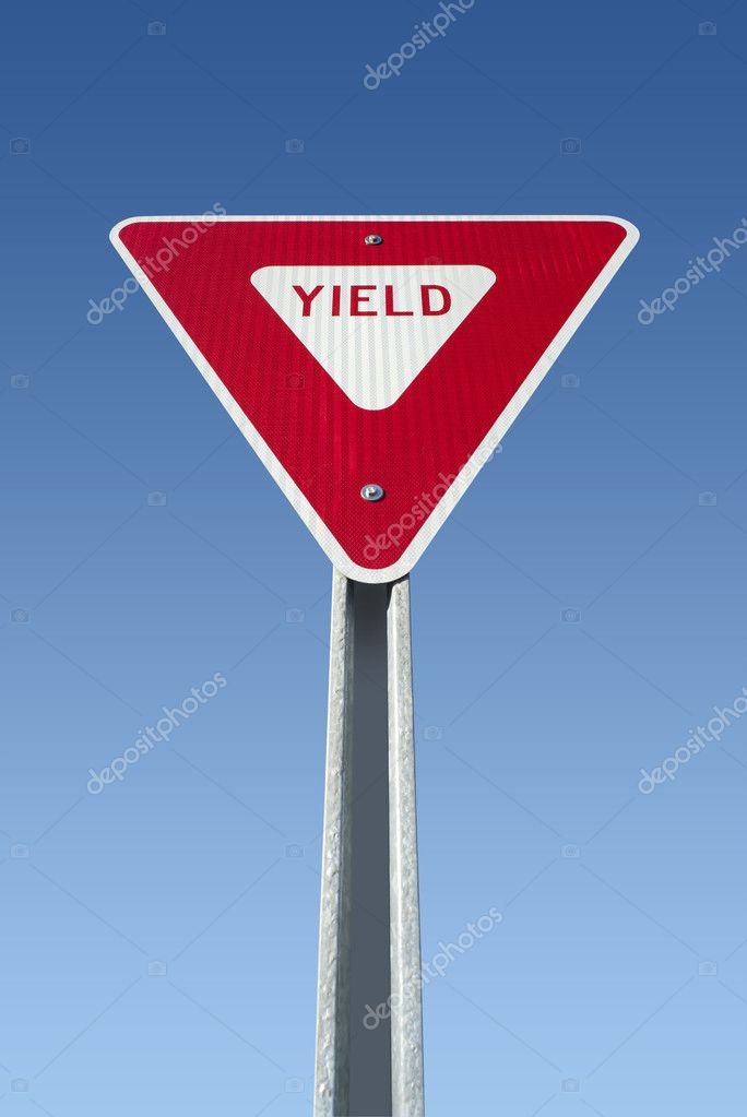 Yield sign on blue sky, isolated with clipping path — Stock Photo #8334054