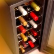 Wine bottles in cooler — Stock Photo