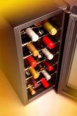 Wine bottles in cooler — Stock Photo